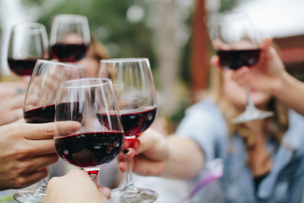 Enjoy a glass of red wine with friends at Gite du Boissillon